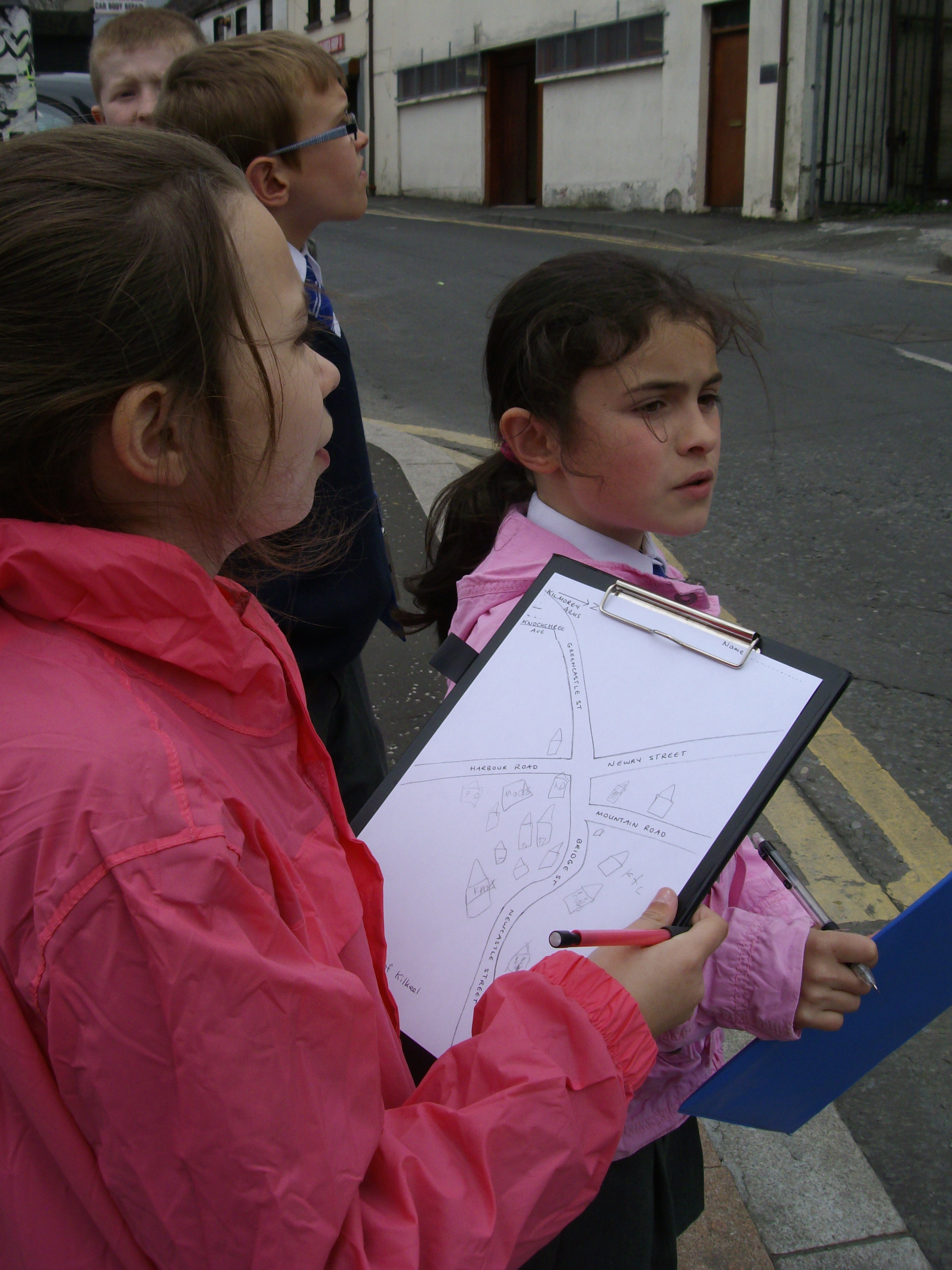 Year 5-7 pupils carrying out investigative work in Kilkeel town centre