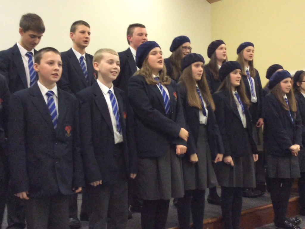 Some of the High School Choir singing, 'Come down and behold the newborn King'