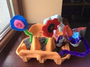 Handmade flowers in playdough soil